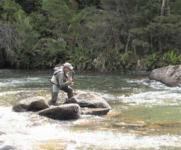 Angler fly fishing the Meander River