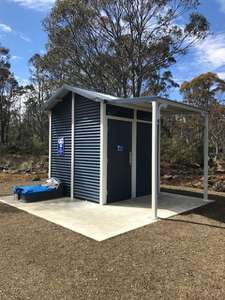 The toilet at on the Arthurs Lake Road opposite the store. A free standing building made of dark blue colour bond.