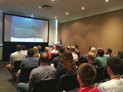 Carp Management Program Leader Jonah Yick presenting work on the management of carp in Lake Sorell at the ASFB conference.